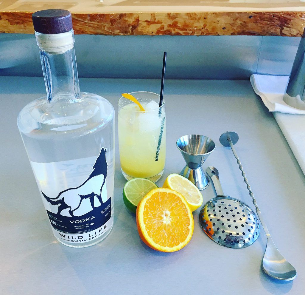 Mixing cocktails with Wild Life Vodka distilled in Alberta